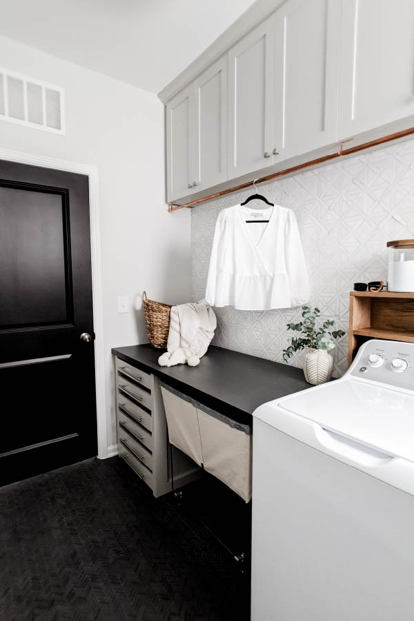 laundry room with folding table and lay flat drying drawers