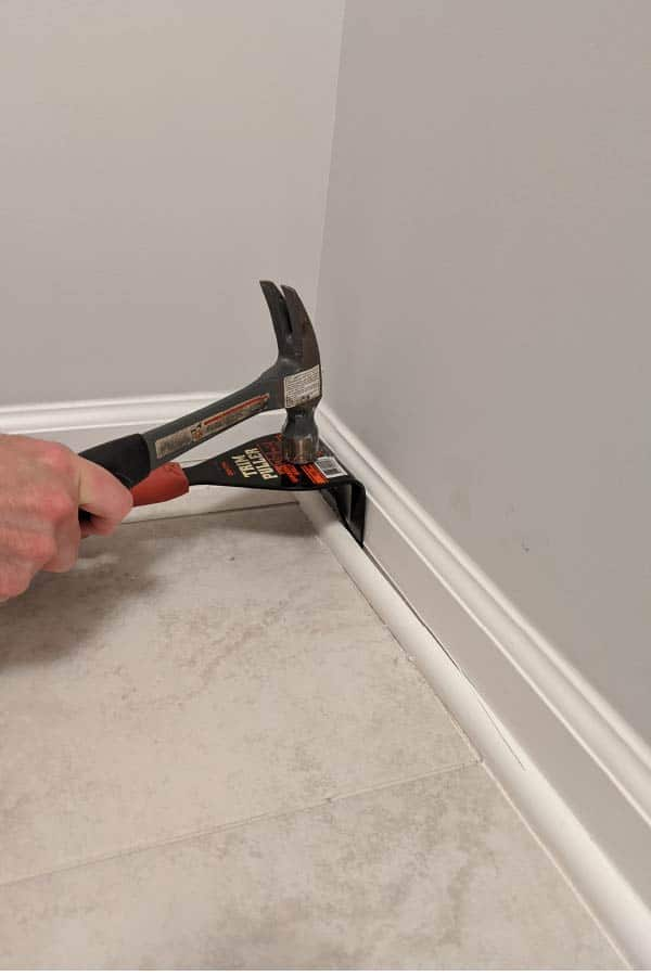 hammering trim puller to separate quarter round from trim