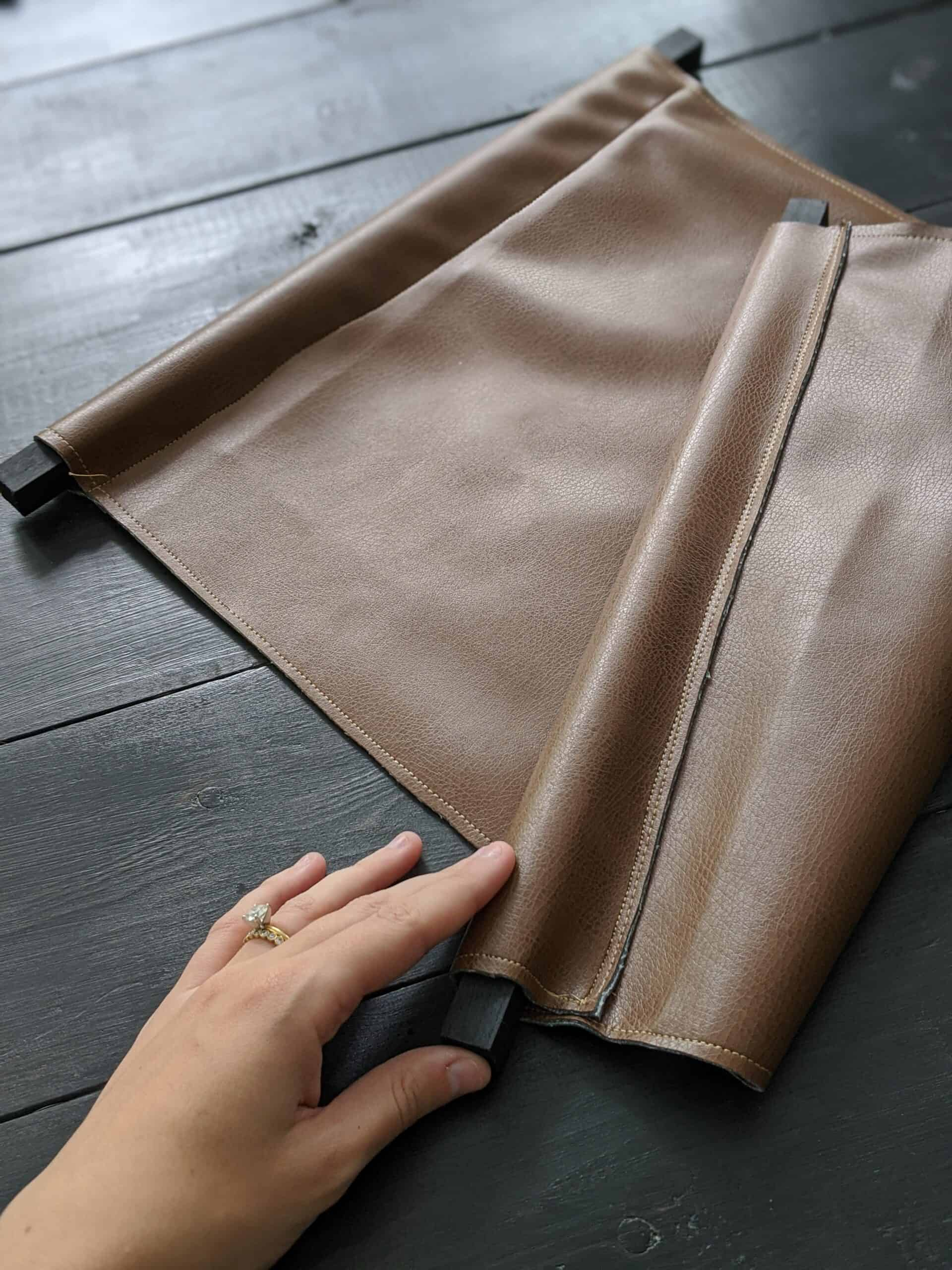 placing square dowel in leather loop