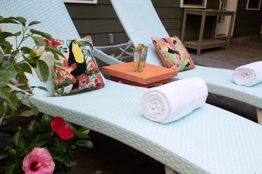 colorful outdoor lounge chairs with tropical pillows