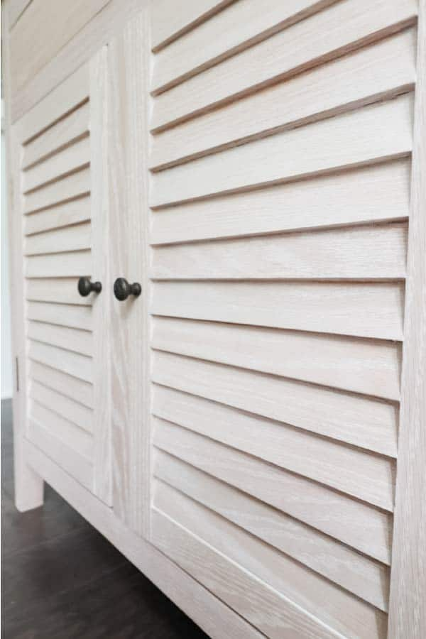 close-up of diy shutter doors in light finish