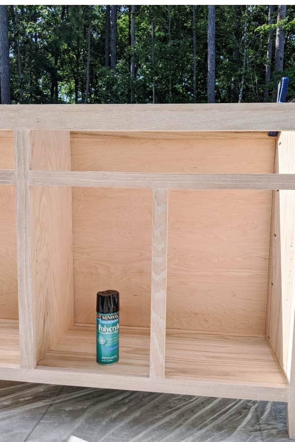 Polycrylic spray sitting inside of DIY sideboard