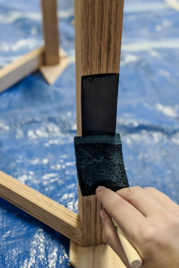 applying Minwax Solid Color Stain using foam brush