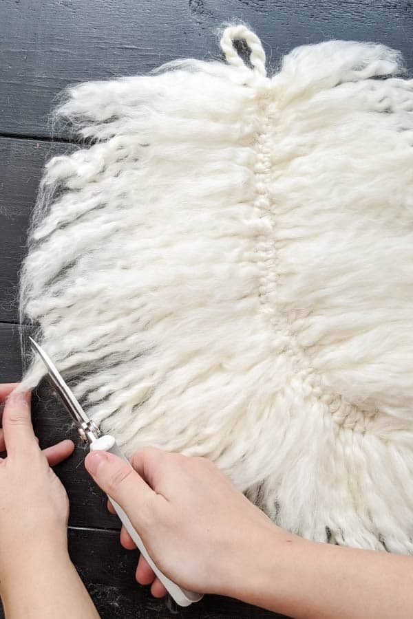 trimming edges of fluffy yarn feather
