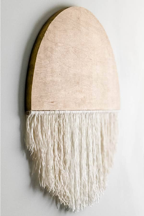 modern boho round wall hanging made from wood and yarn