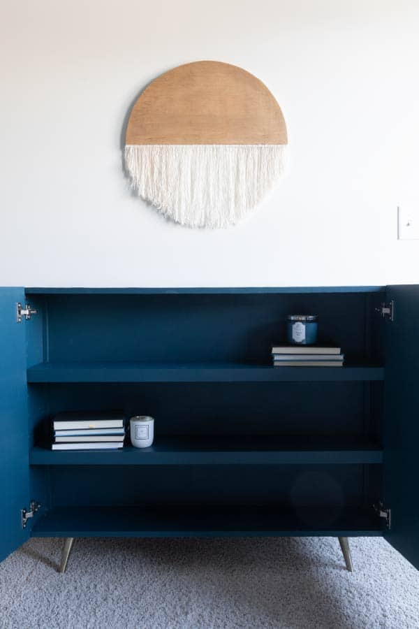blue mid-century modern credenza with hidden storage