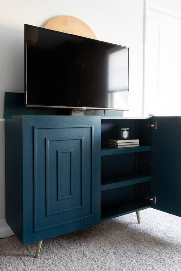 TV coming out of cabinet with hidden storage