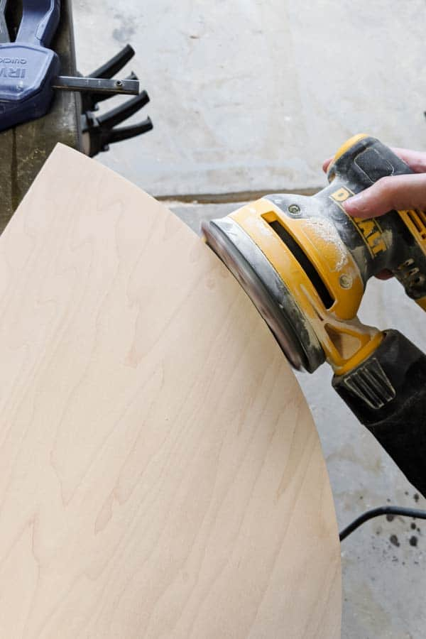 sanding edges of plywood half circle