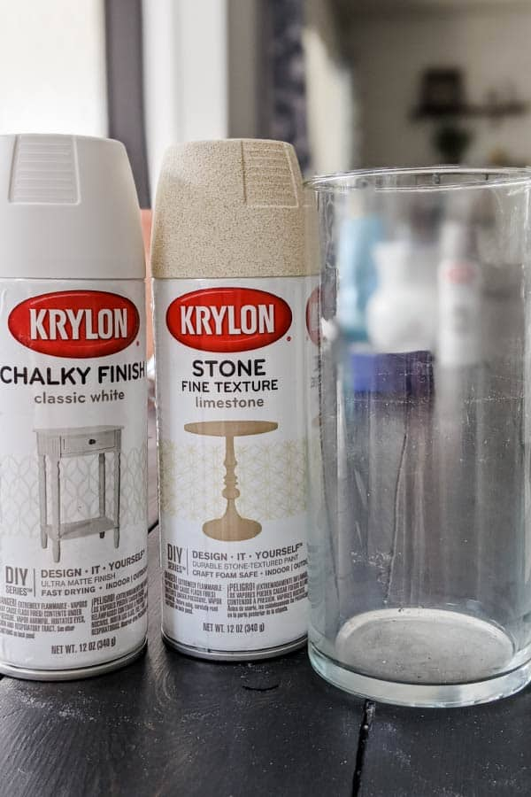Krylon Chalky Finish in Classic White and Krylon Stone Fine Texture in Limestone next to glass vase before getting spray painted