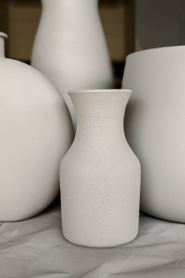 close up of vases sprayed with Limestone spray paint and Paver Gray spray paint