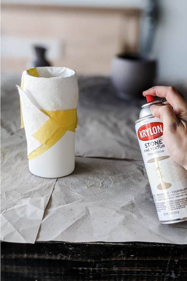 Painting bottom of vase with stone texture spray paint