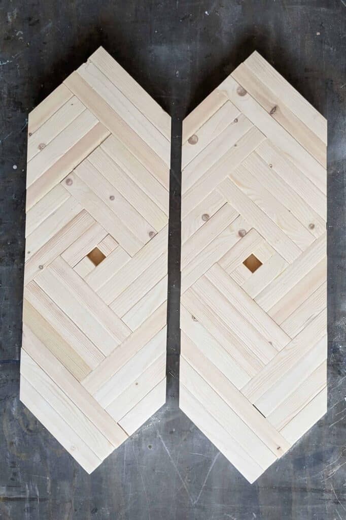 DIY geometric wall art set before staining