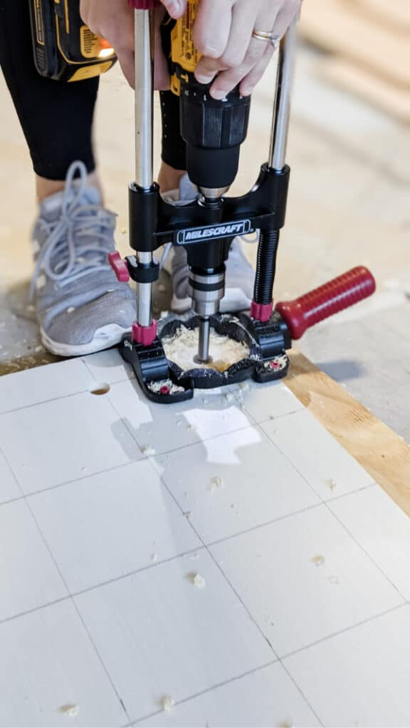 using drill guide to drill holes into plywood