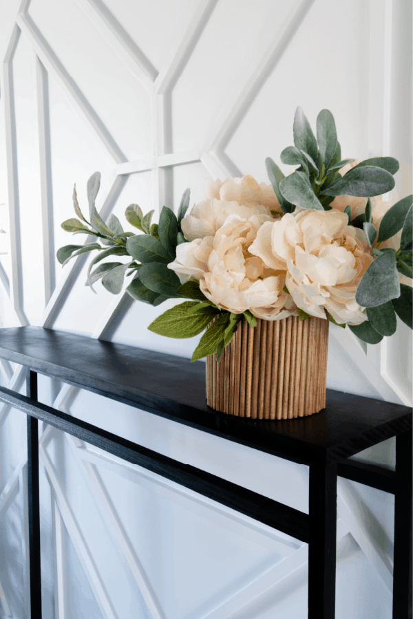 Wood fluted vase sitting on black console table