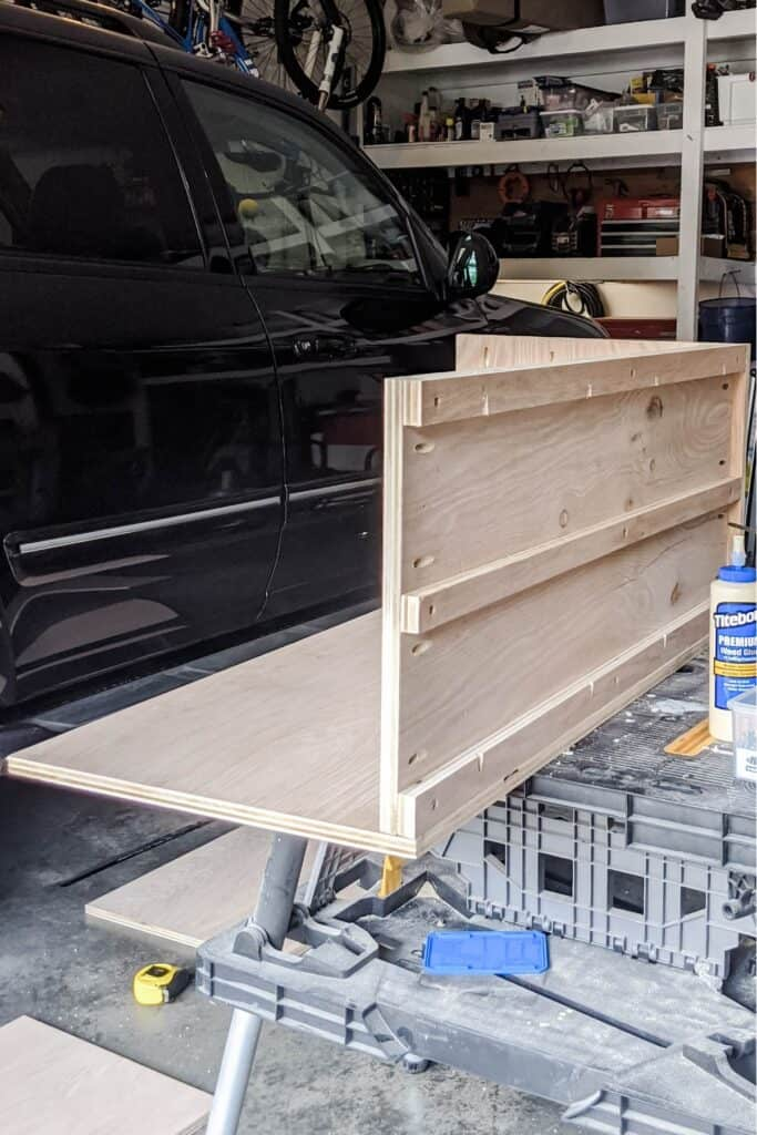 attaching plywood back to side and bottom