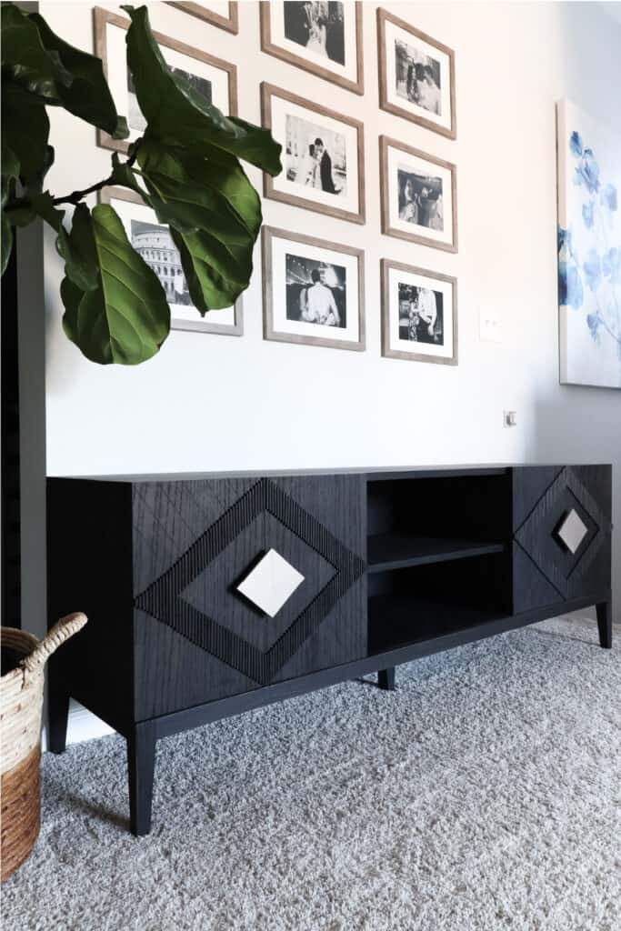 modern black media console with patterned doors and diamond handles