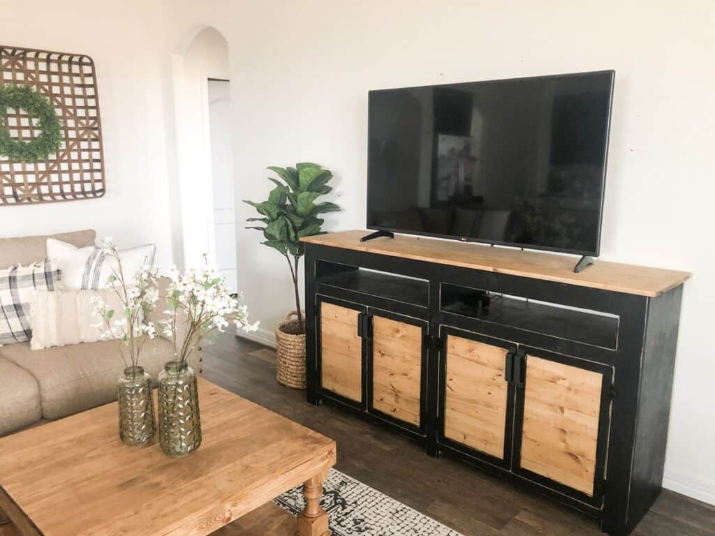black and wood two-toned media console