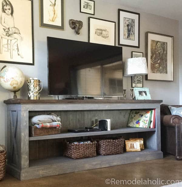 TV sitting on farmhouse sideboard with open shelving