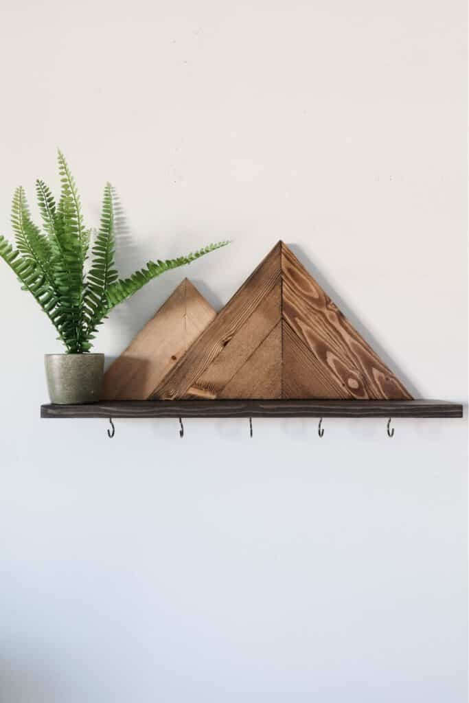 mountain shelf made from wood with hooks for keys