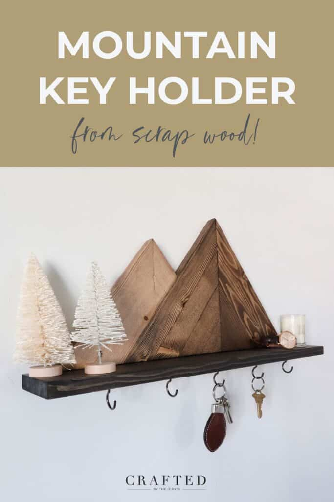 mountain key holder from scrap wood with mini trees sitting on shelf