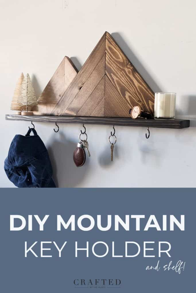DIY mountain key holder and shelf with candle and watch on it