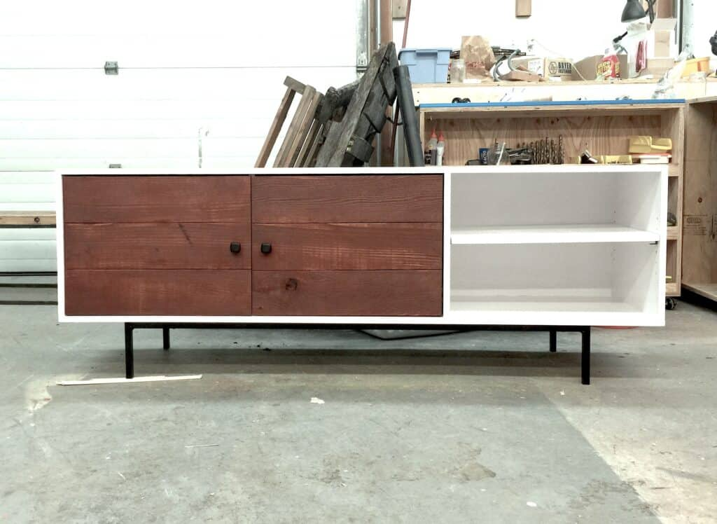mid-century modern tv stand with 2 wood doors and open shelving