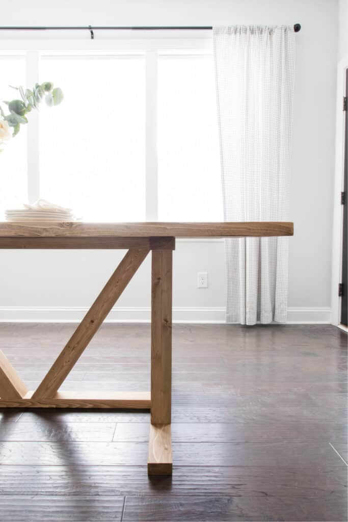 view of half of DIY dining table showing off angled brace