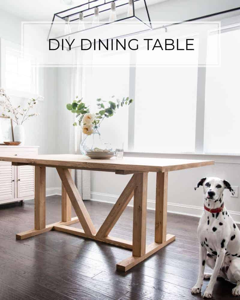 Dalmatian sitting in front of DIY dining table