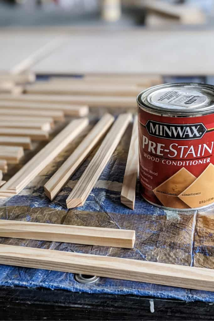 Minwax pre-stain wood conditioner next to pine boards that has been cut down