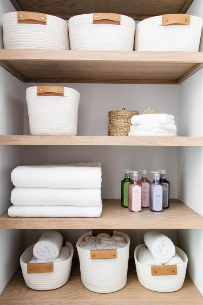 light and airy linen closet with oak plywood shelves and white rope baskets