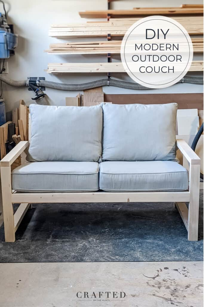 DIY modern outdoor couch with light gray cushion in garage before staining