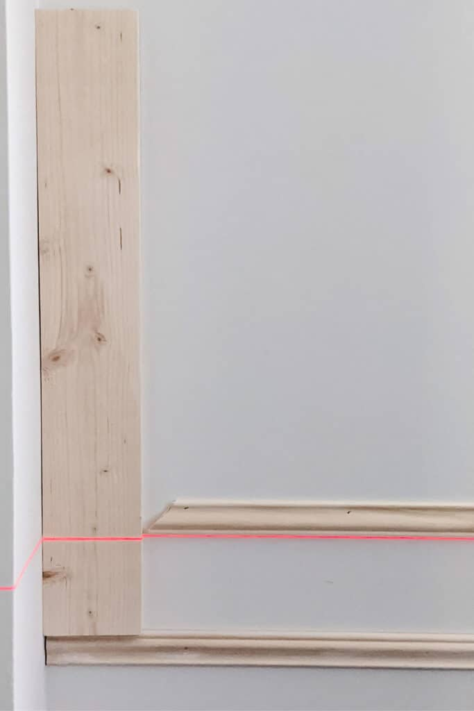 picture frame molding lined up with laser level line