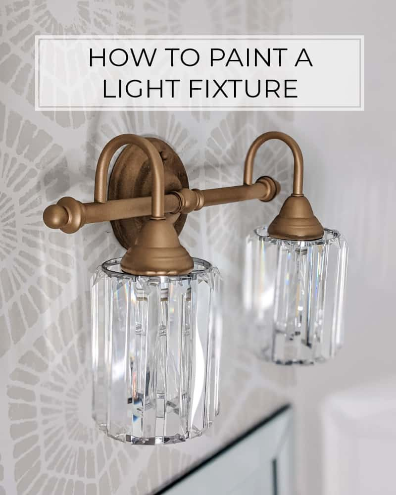 how to paint a light fixture - close up of gold spray painted light fixture with glass shades
