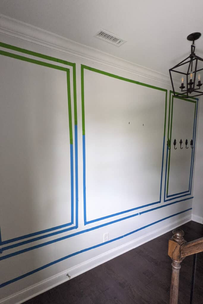 taping wall trim design on wall